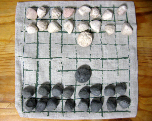 My latrunculi set - pebbles in a storage bag that doubles as a board. Thanks, Ine!