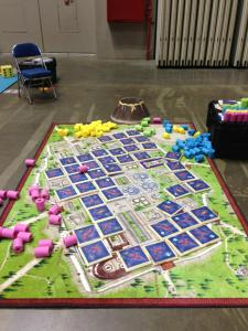 The back-breaking, giant-sized Pompeii game board at Gen Con 2013.