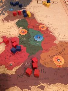 The King is Dead at our game table. So far the Romano-British (yellow tokens) have won power struggles, but the Welsh (red) may have a shot at grabbing the next two regions.